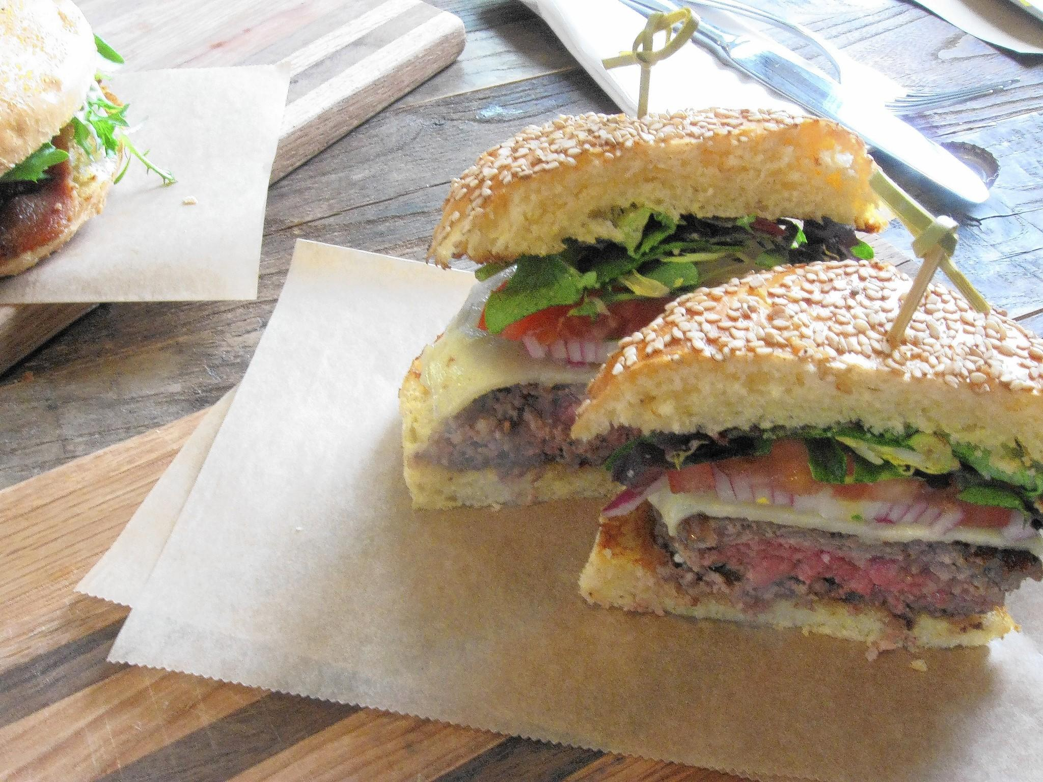The Craft Classic is served with American or cheddar cheese, lettuce, tomato and onion.