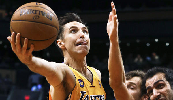 Steve Nash drives past Hamed Haddadi and Goran Dragic during a Lakers game against the Phoenix Suns in March.