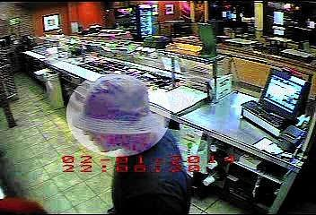 A surveillance photo of the robbery suspect.