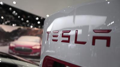Tesla Motors ends year with higher sales but still a big loss
