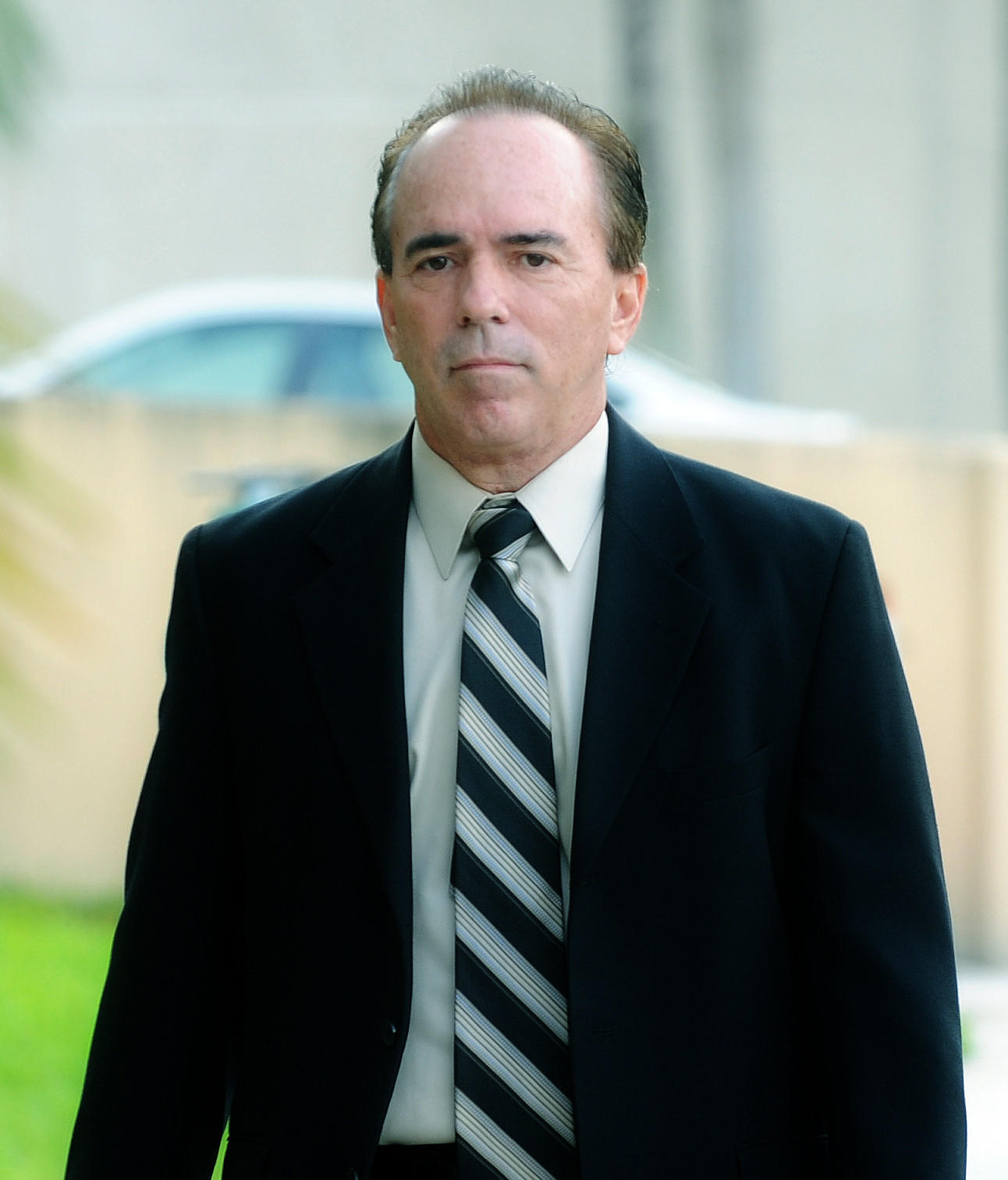 Attorney Douglas L. Bates arrives for a hearing at the federal courthouse in West Palm Beach earlier this year. Bates, who lives in Parkland and practiced law in Plantation, is charged with assisting Ponzi schemer Scott Rothstein.