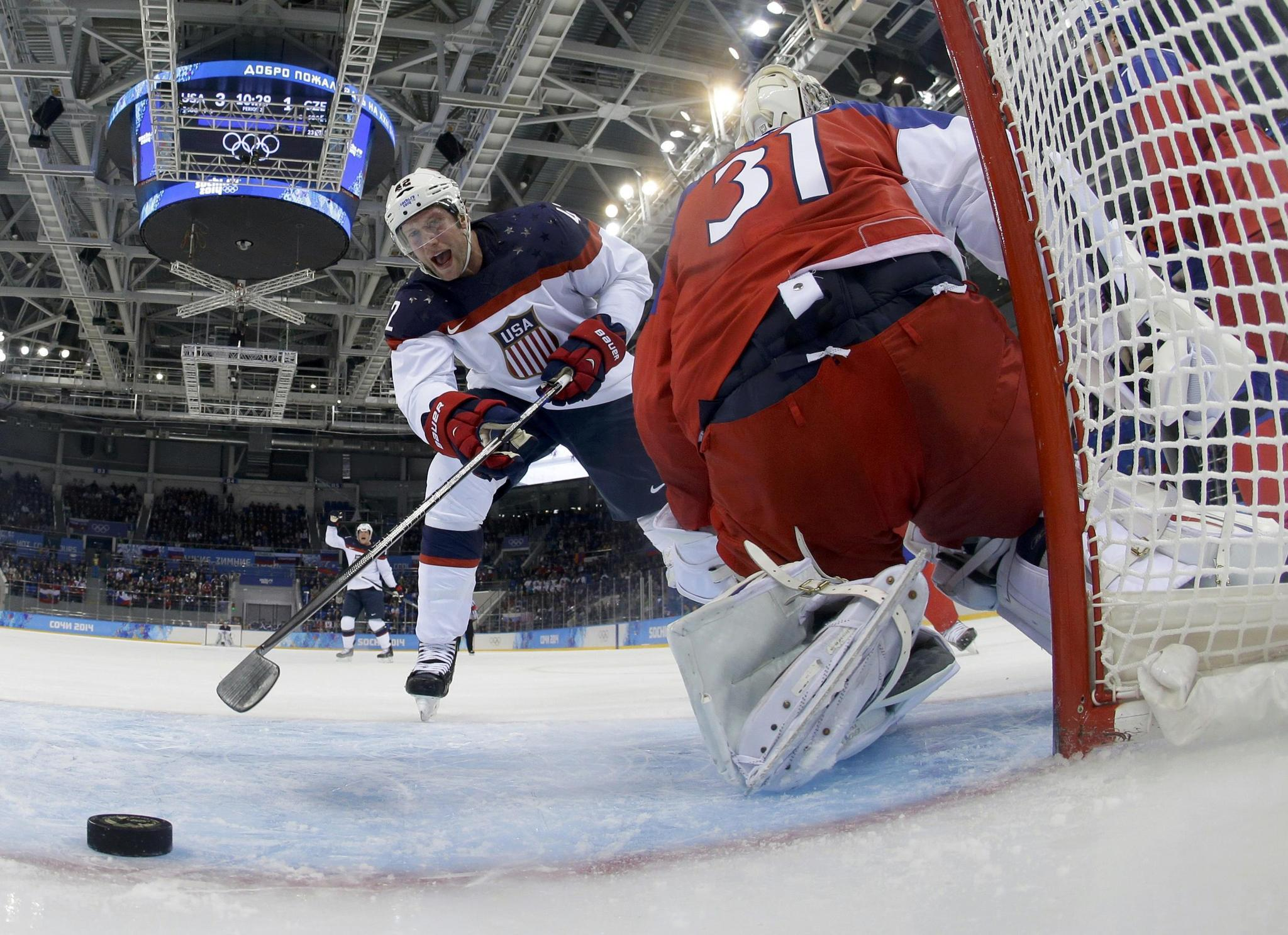 Team USA's David Backes reacts as the puck crosses the goal line past Czech Republic's goalie Ondrej Pavelec Wednesday.