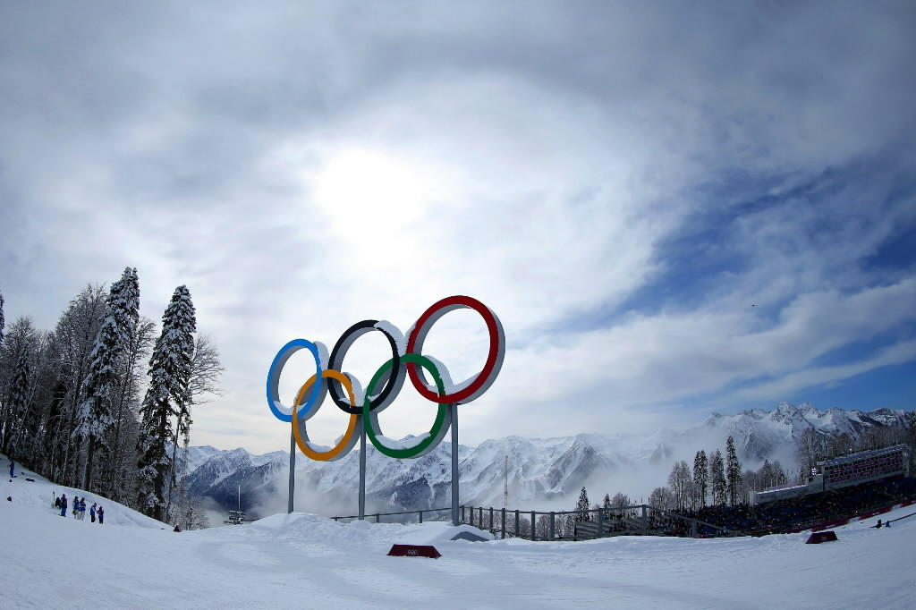 Mist rises behind the Olympic Rings on Wednesday in Sochi, Russia.