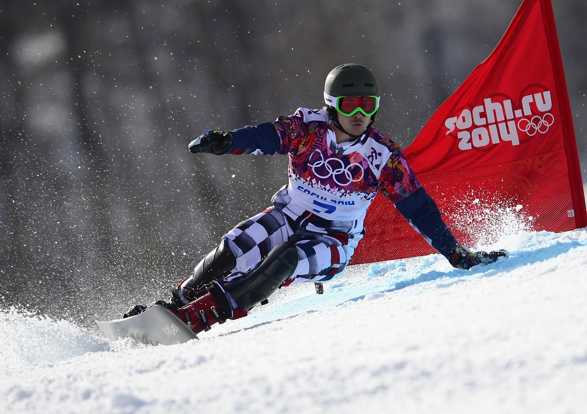 Vic Wild claimed the gold medal in the men's snowboard parallel giant slalom Wednesday for Russia, the country he left the United States for in 2011.