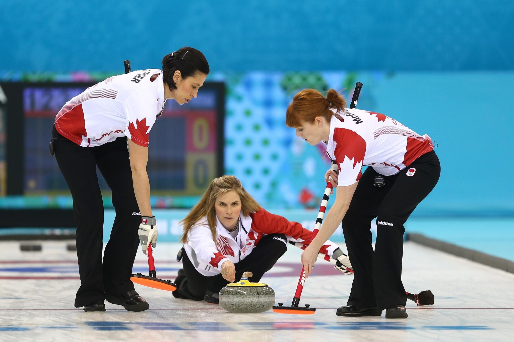 Jennifer Jones of Canada releases the stone during the women's semifinal match between Great Britain and Canada at Ice Cube Curling Center.