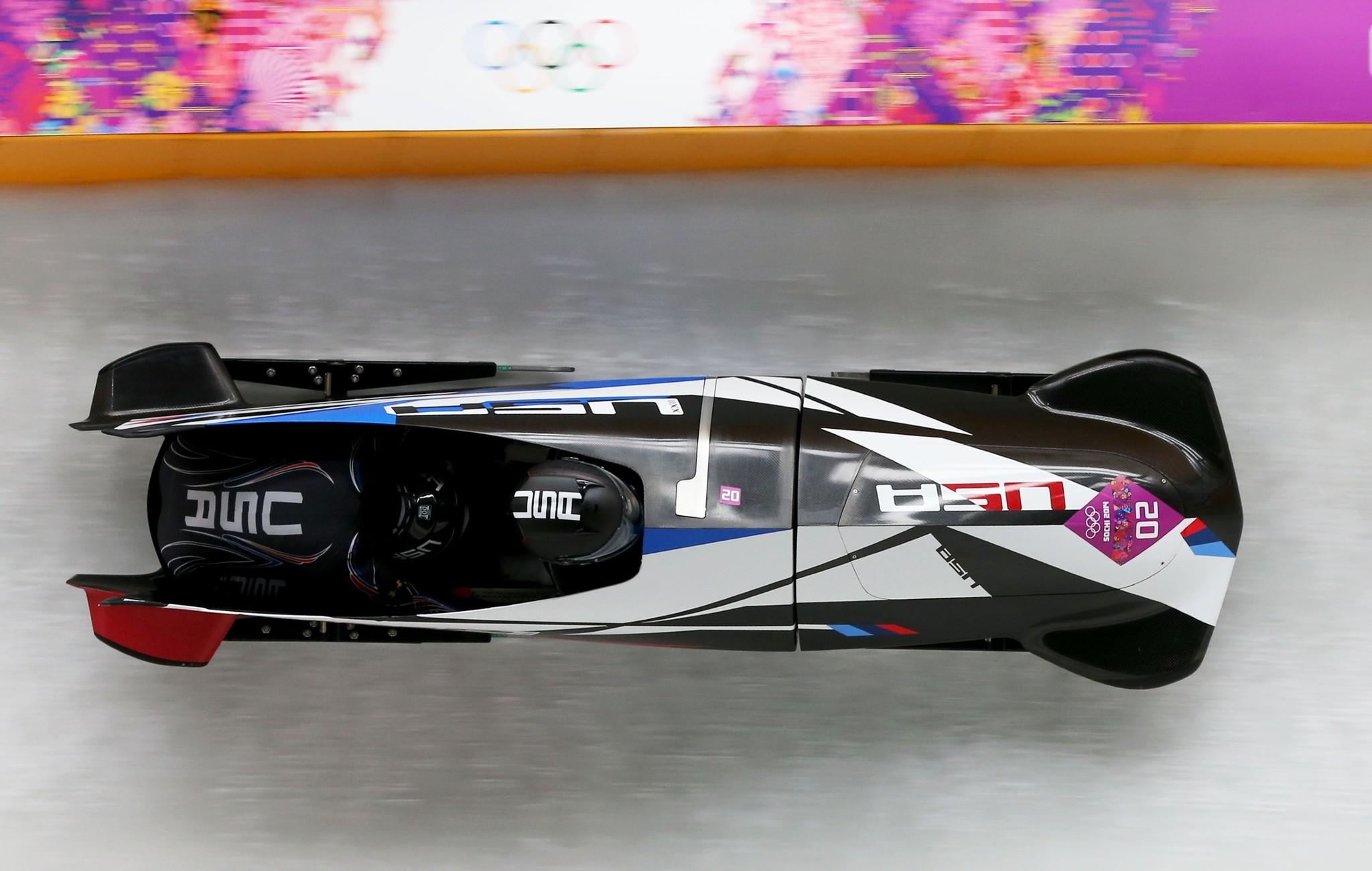 Pilot Elana Meyers and brakeman Lauryn Williams fly down the bobsled course at the Sanki Sliding Center en route to a silver medal finish Wednesday.