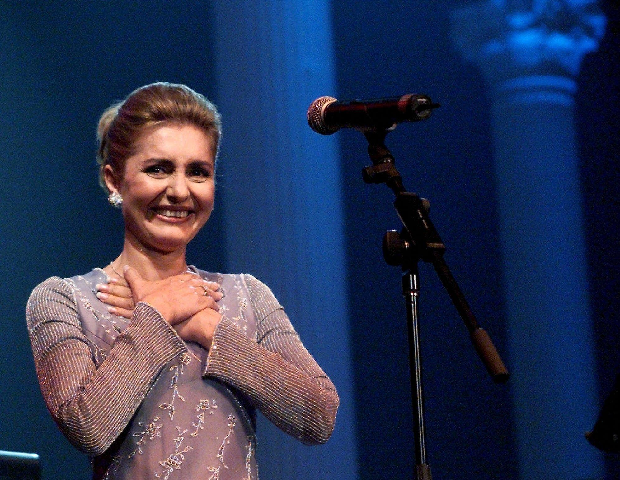 Iranian singer Googoosh weeps as she stands on stage during a concert in Toronto in 2000. It was her first concert since Iran's 1979 Islamic Revolution halted her career.