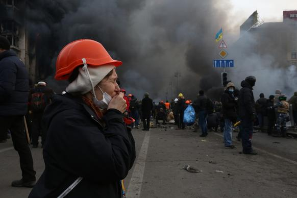 A protester prays in the middle of Independence Square in Kiev.