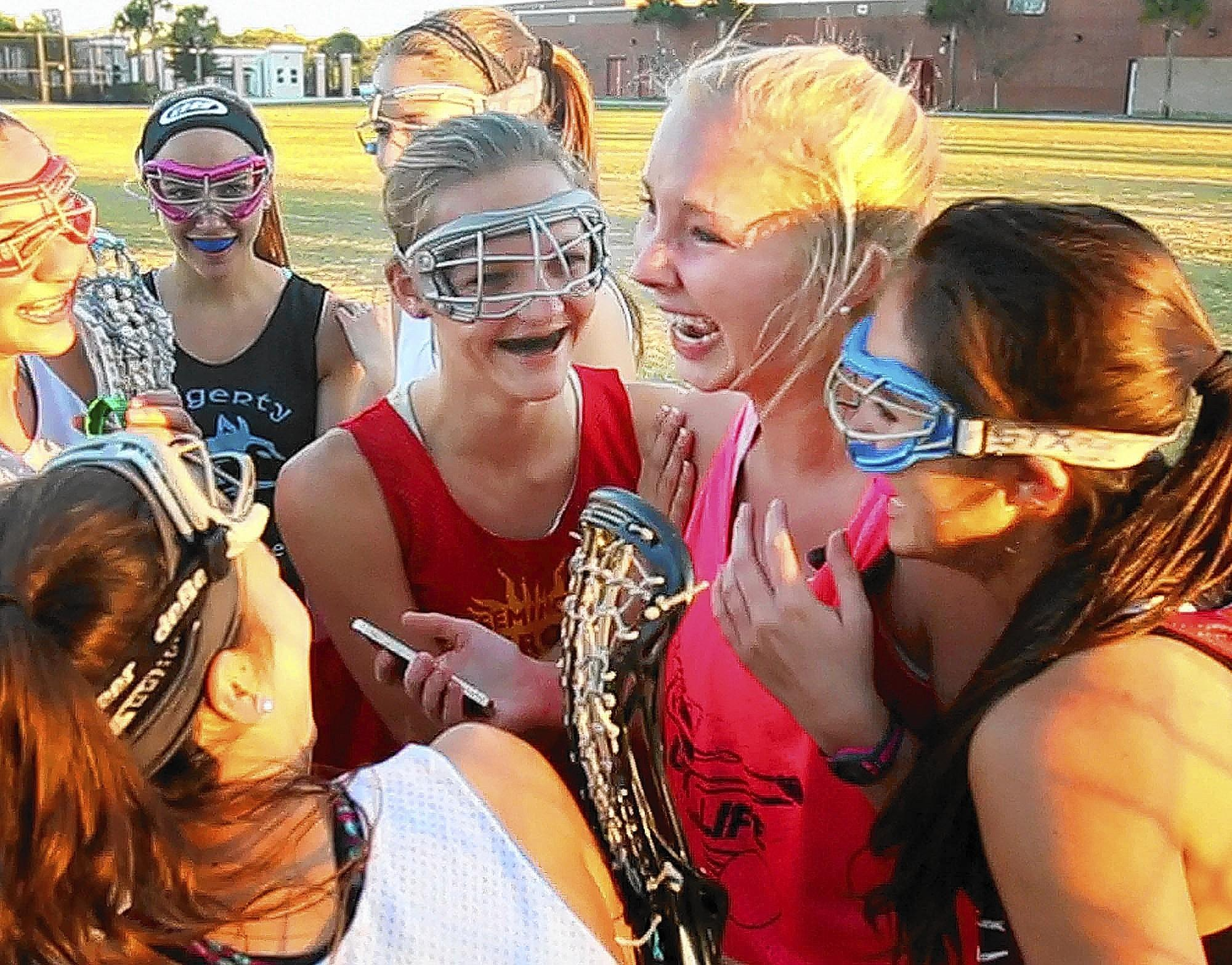 Hagerty High lacrosse player Lizzie Connor reacts with her teammates after finding out (via email on her phone) that she's been accepted at the University of Florida on Friday, February 14, 2014.