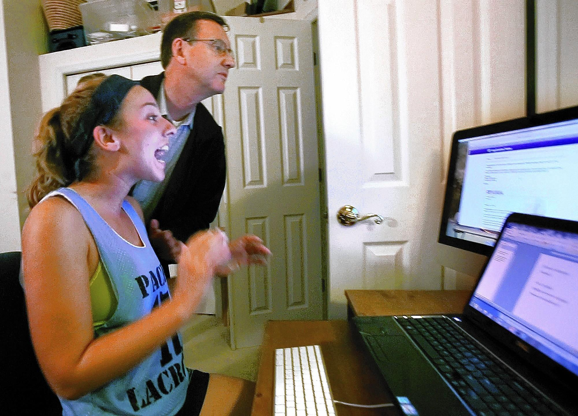 Hagerty High lacrosse player Matilda von Kalm reacts after finding out via email that she's been accepted at the University of Florida on Friday, February 14, 2014. She is at her home, and her father, Lawrence.