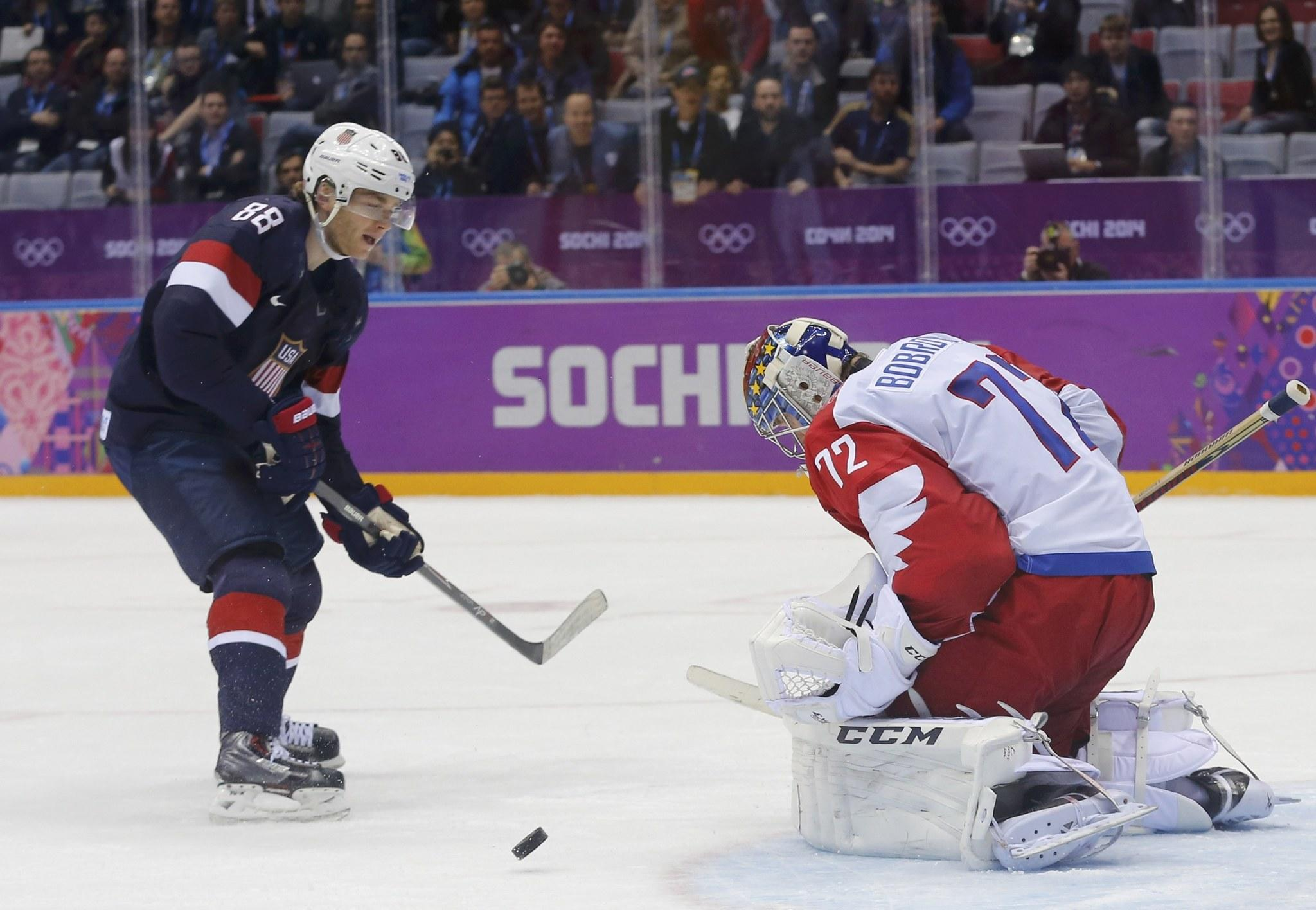 Russia's goalie Sergei Bobrovski makes a save on a breakaway by Team USA's Patrick Kane during overtime in their men's preliminary round ice hockey game at the 2014 Sochi Winter Olympic Games on Feb. 15