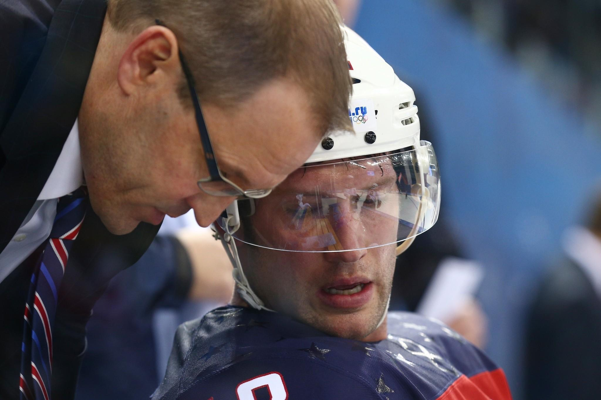 Coach Dan Bylsma talks with Blake Wheeler on the bench during the United States' quarterfinal win Wednesday over the Czech Republic, 5-2. The U.S. will face Canada in the semifinals Friday.