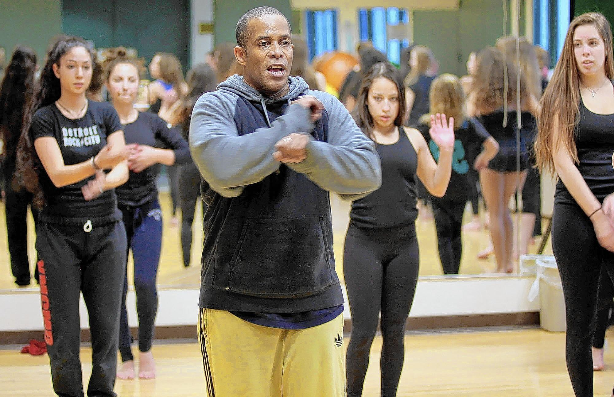 Sean Cheesman rehearses choreography with Flintridge Sacred Heart Academy students.