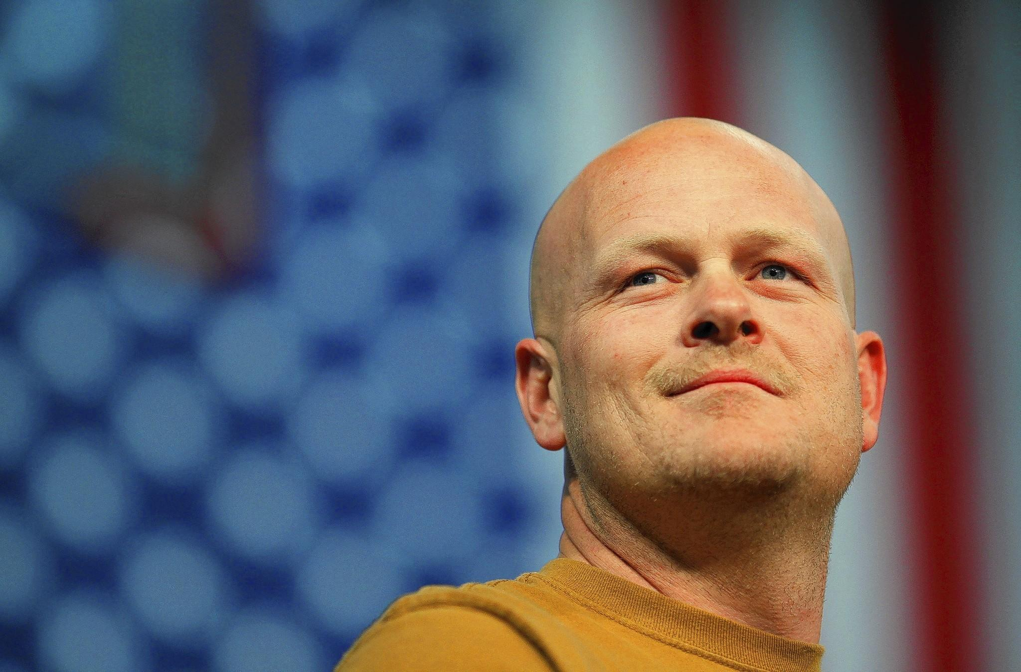 """Joe Wurzelbacher, also known as """"Joe the Plumber,"""" stands onstage at a campaign rally in Ohio in this file photo taken on Oct. 30, 2008."""