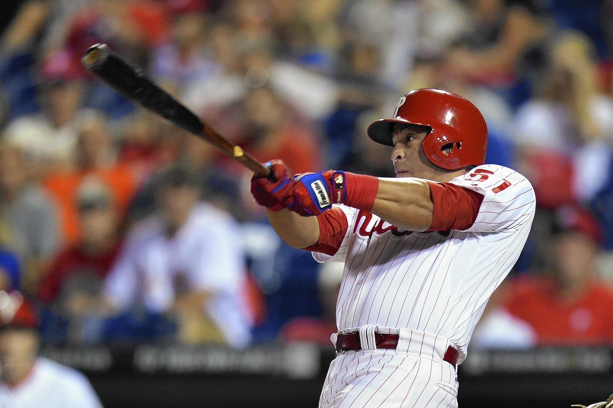 Carlos Ruiz #51 of the Philadelphia Phillies hits a two-run double in the first inning against the San Diego Padres at Citizens Bank Park on September 12, 2013 in Philadelphia, Pennsylvania.