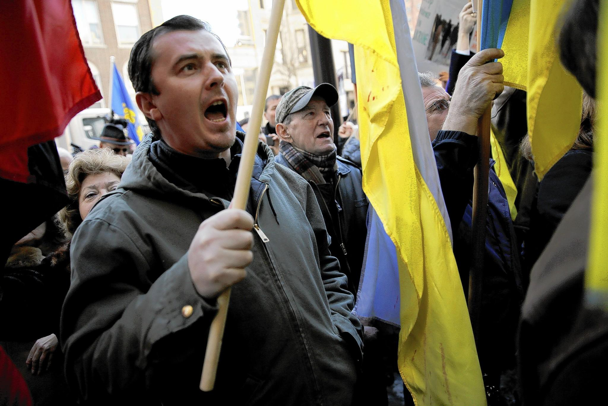 Protesters gather outside the Consulate General of Ukraine Wednesday to denounce the country's recent string of deadly violence during demonstrations and to demand that Western leaders intervene.