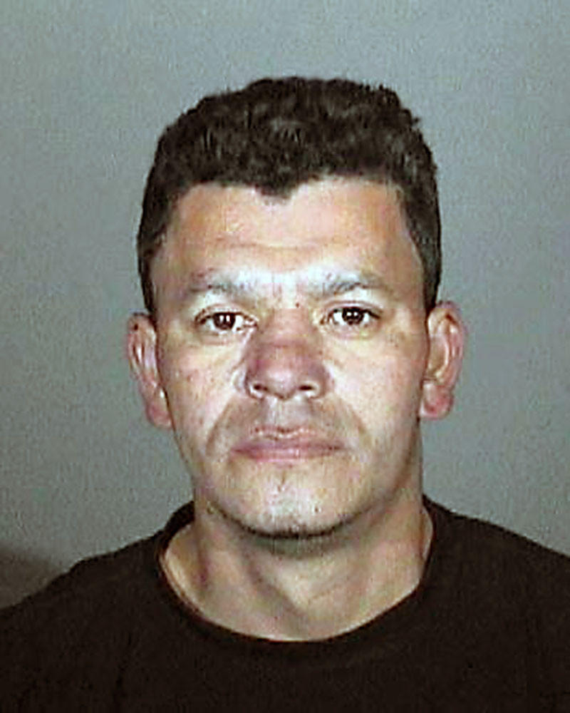 Elmer Giron was arrested on suspicion of brandishing a machete to passing vehicles.