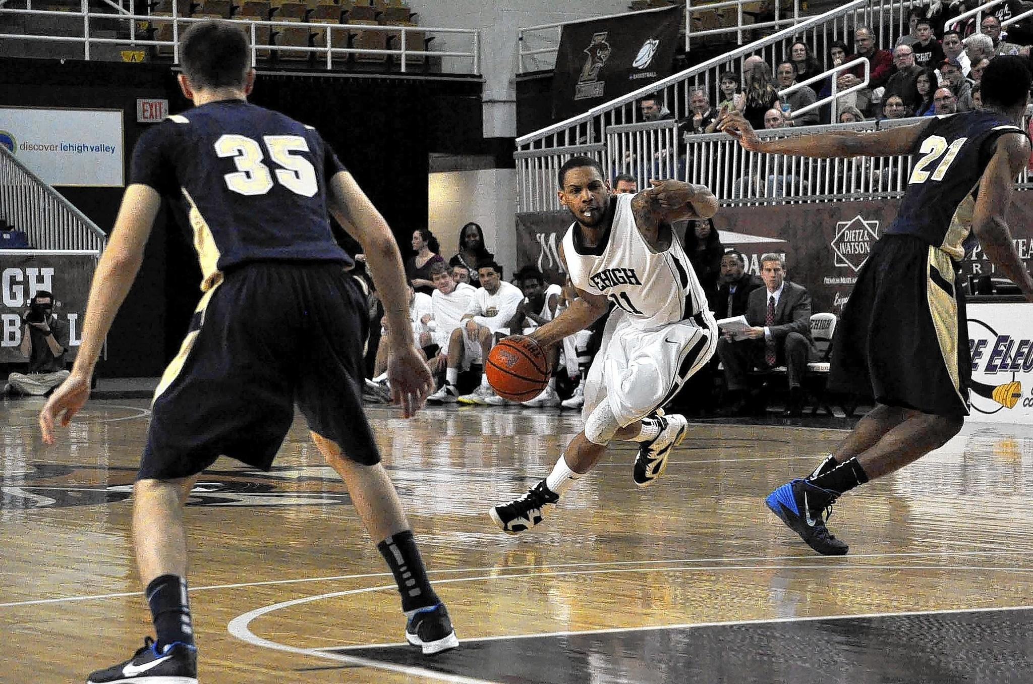 Mackey McKnight drives the ball towards the basket during the game against Navy on February 19, 2014.