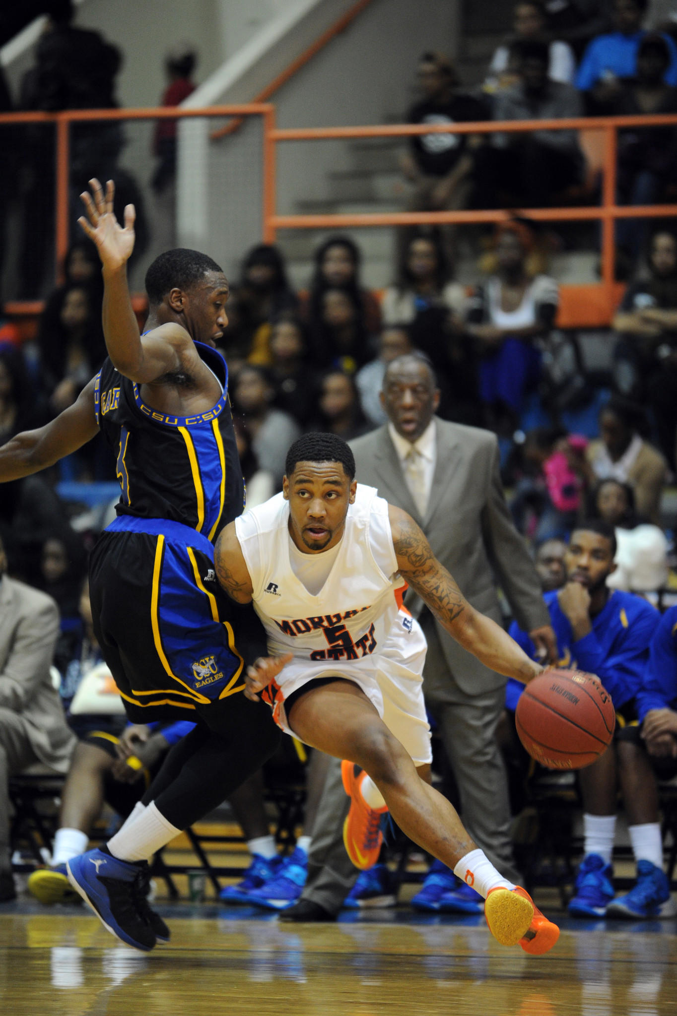 Morgan State's Justin Black drives past Coppin State's Dallas Gary.