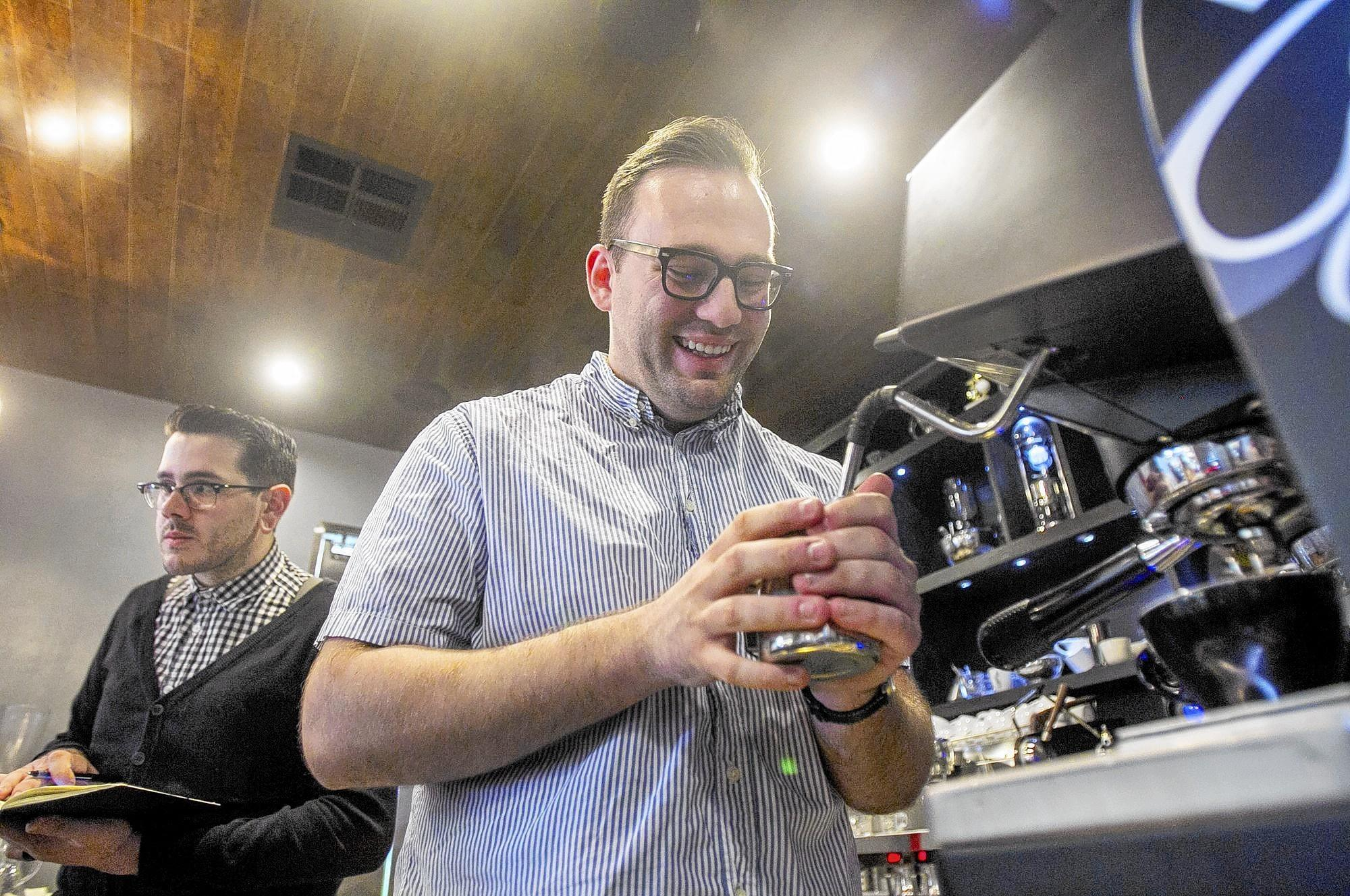 Truman Severson, left, and Andrew Ogden, baristas at Portola Coffee Lab, practice Wednesday at the shop for a competition this weekend in Los Angeles.