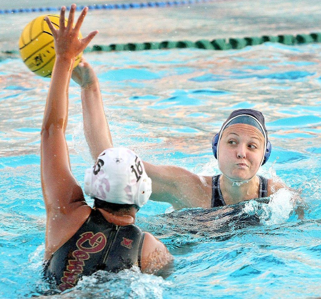 Crescenta Valley High'ss Natalie Krebsbach takes a shot on goal attempt past a Downey defender during a CIF Southern Section Division V first-round match at Burbank High on Wednesday. (Roger Wilson/Staff Photographer)