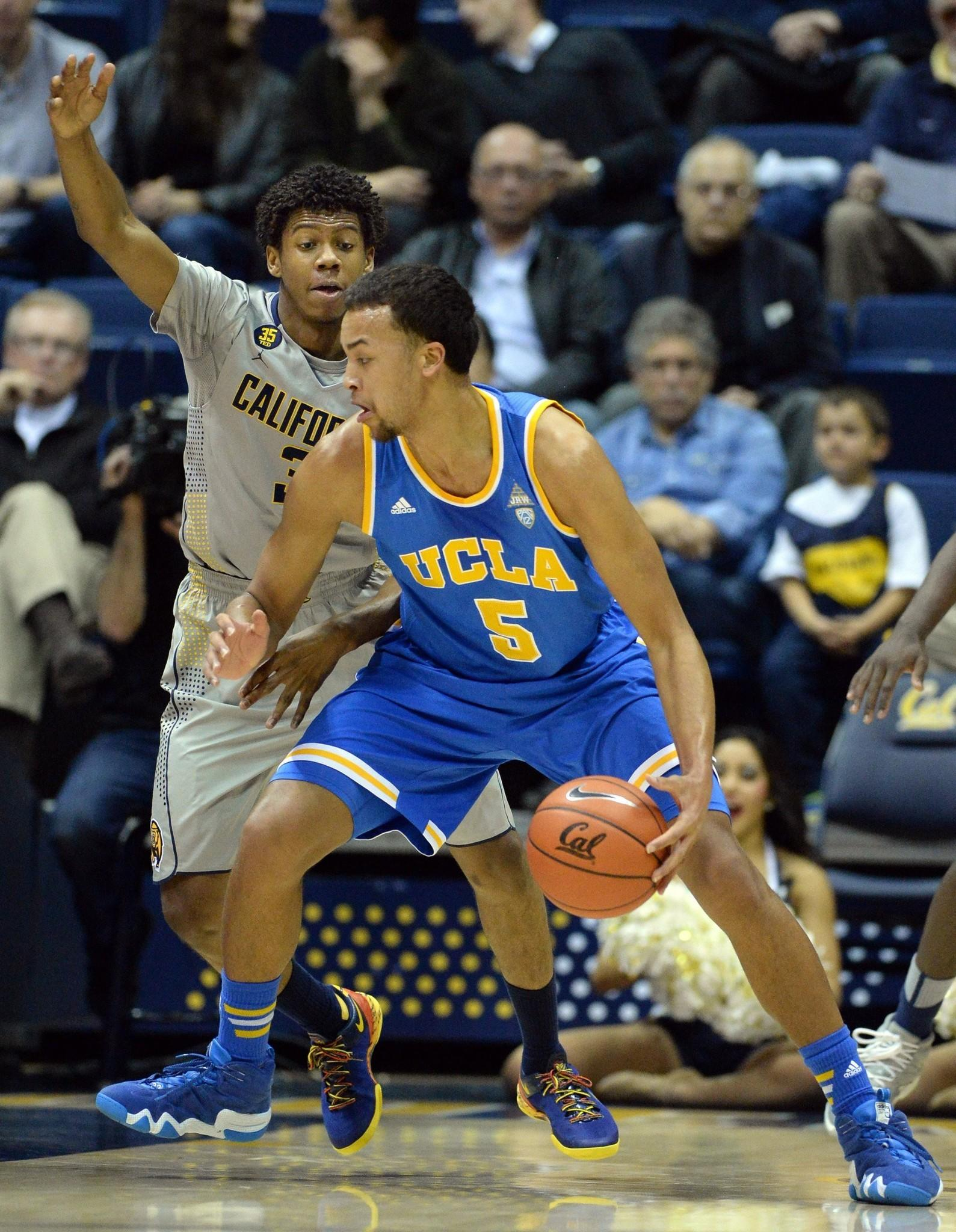UCLA's Kyle Anderson is defended by California's Tyrone Wallace during the first half of the Bruins' 86-66 win Wednesday over the Golden Bears at Haas Pavilion in Berkeley, Calif.
