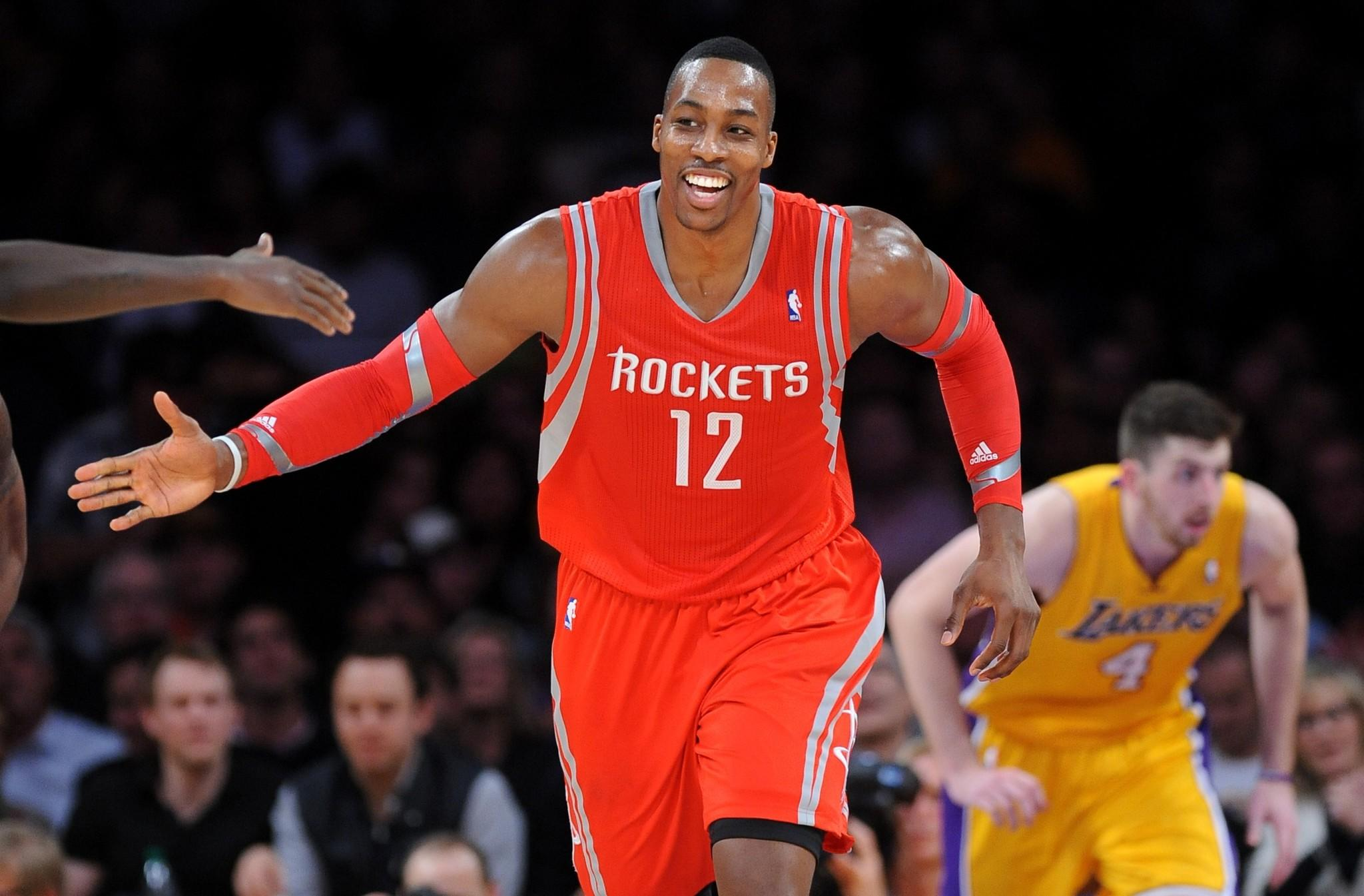 Rockets center Dwight Howard celebrates with a teammate after dunking against the Lakers.