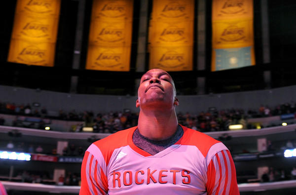 Rockets center Dwight Howard listens to the national anthem before playing his first game at Staples Center against the Lakers since leaving for Houston as a free agent.