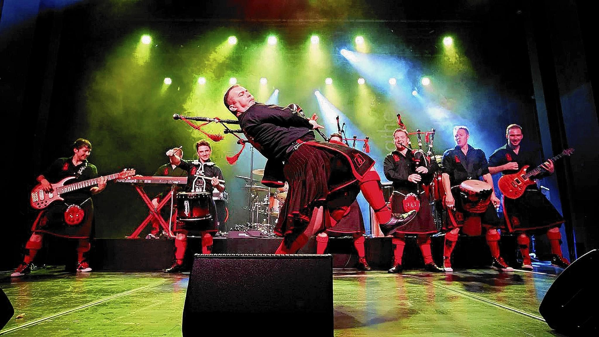 The Red Hot Chilli Pipers, with director Kevin MacDonald (center), will perform at the State Theatre, Easton, on Feb. 20.
