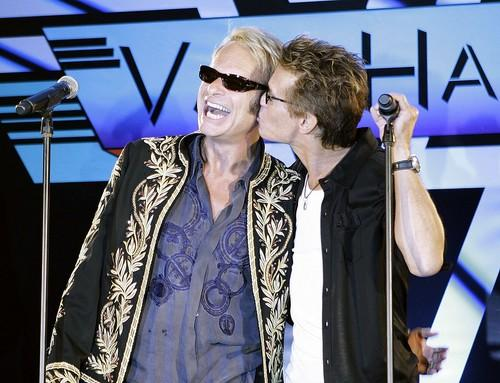 David Lee Roth, left, gets a kiss from his former bandmate in Van Halen, Eddie Van Halen, after they announced the bands north American tour during a news conference at the Four Seasons Hotel in Los Angeles.