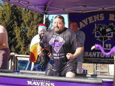 Bill Meadowcroft, a Freeland resident and vice president of Ravens Roost 99, comes up for air after a dunk in a water tank to raise money for Maryland Special Olympics. Meadowcroft owns A-Town Bar and Grille, in Hampstead, where the tank was available to Roost members on a freezing cold Jan. 18.