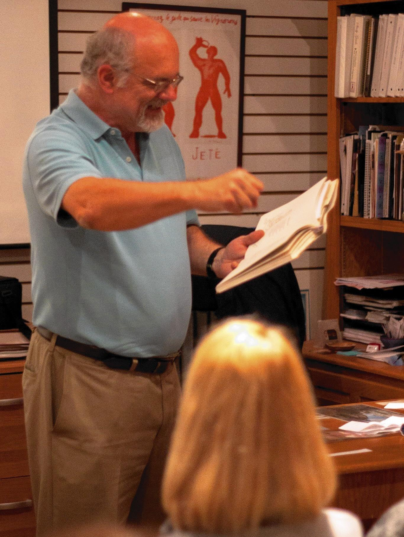 Writer Terry Black of Mission Viejo reads during the last DimeStories event held at the Laguna Culinary Arts. The group is moving to Costa Mesa.