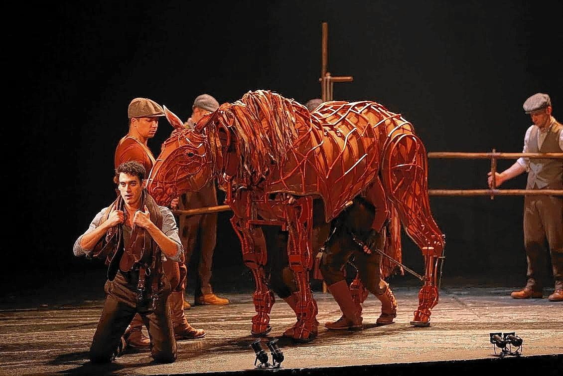 "Albert (Michael Wyatt Cox, foreground) is devoted to his horse, Joey, in ""War Horse."""