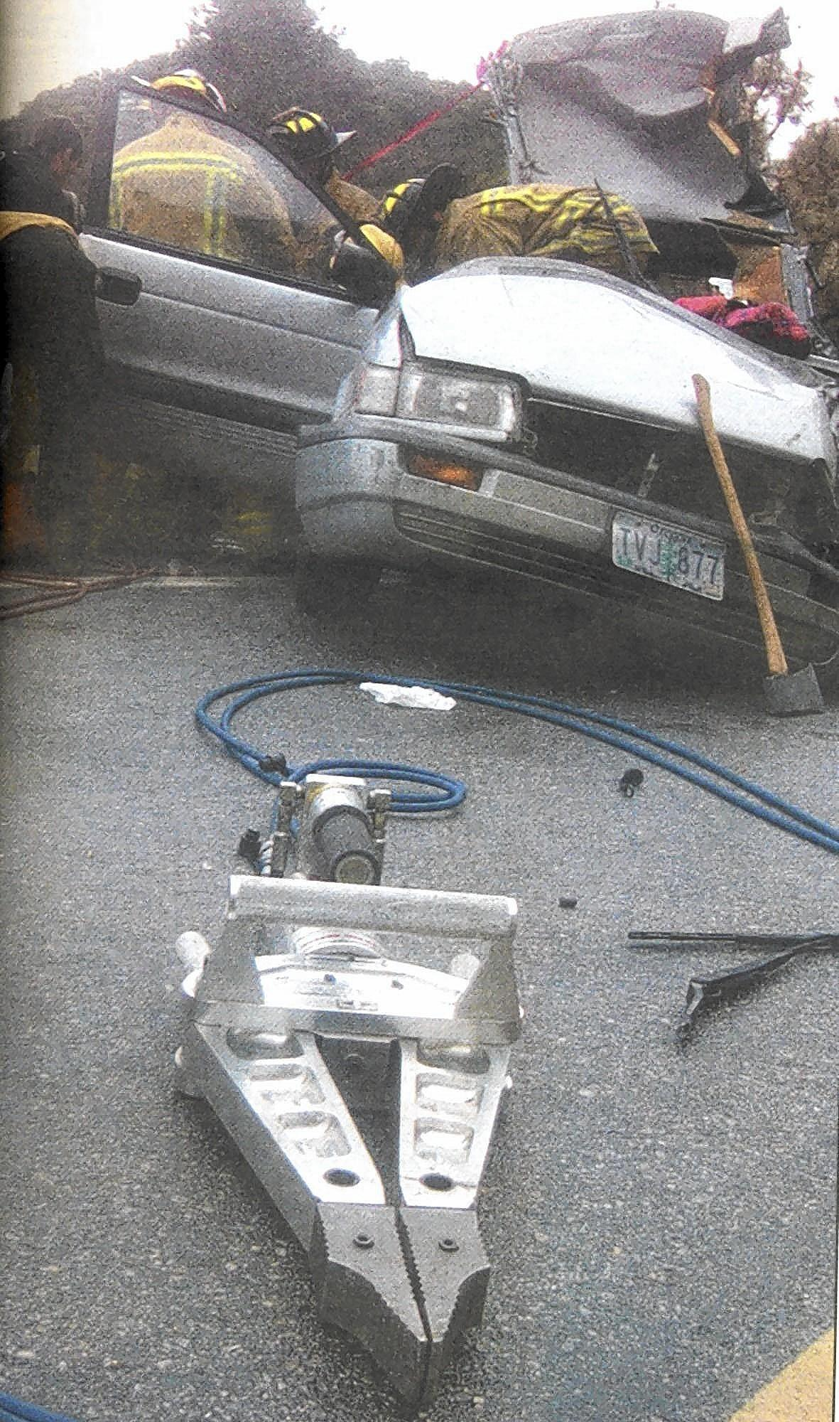The Jaws of Life were used to peel back the top of a 1993 Mitsubishi Expo so rescuers could extract its driver and a passenger after the car collided on Angeles Crest Highway with a Forest Service truck on Feb. 20, 2004. The 23-year-old driver of the Expo did not survive his injuries.