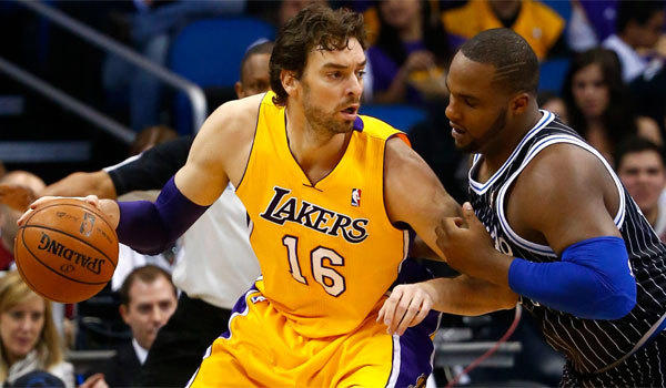 Pau Gasol takes on Orlando's Glen Davis in a game in January.