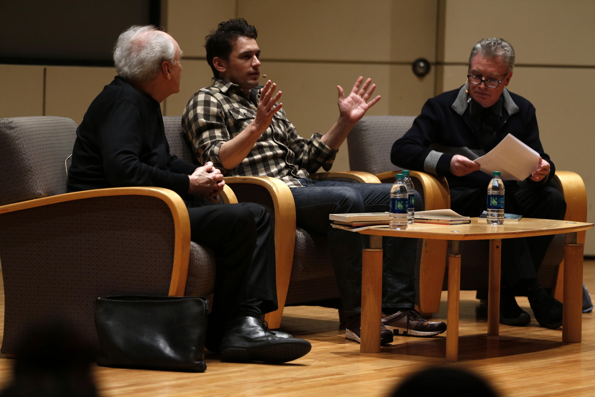 James Franco and poet Frank Bidart (left) are interviewed by Robert Polito during Chicago Humanities Festival poetry event at Thorne Auditorium in Chicago.