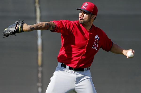 Angels pitcher Hector Santiago warms up during a spring training workout on Saturday.