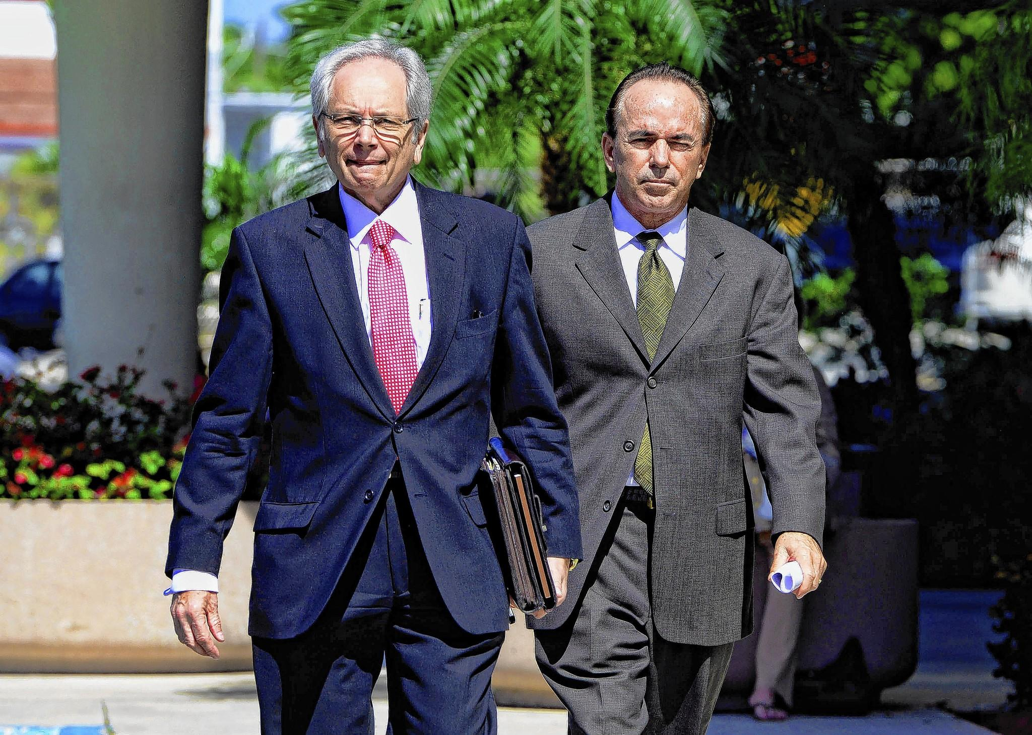 Doug Bates, (right) a Broward County lawyer, leaves Federal Court in West Palm Beach with his attorney, Leonard Sands, after pleading guilty to one count of conspiracy to commit wire fraud in connection with the Scott Rothstein's ponzi scheme.