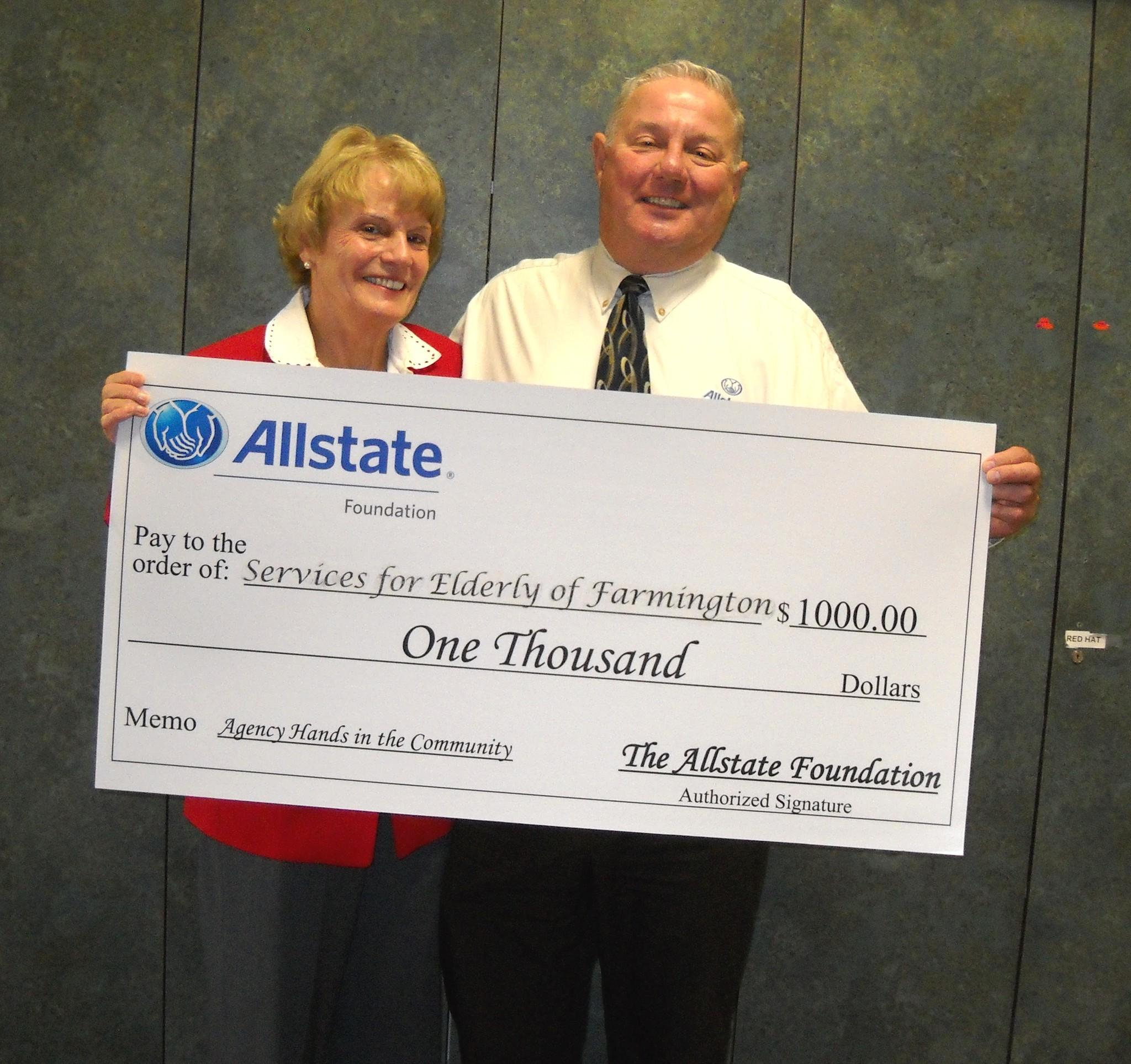 Allstate Agent and Meals on Wheels volunteer Ray Zailskas presents Nancy Walker, executive director of Services for the Elderly of Farmington, with a $1,000 check from The Allstate Foundation.