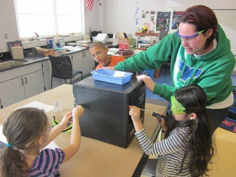 With the help of volunteers, students at the Glastonbury-East Hartford Magnet School explore the inner workings of common objects.