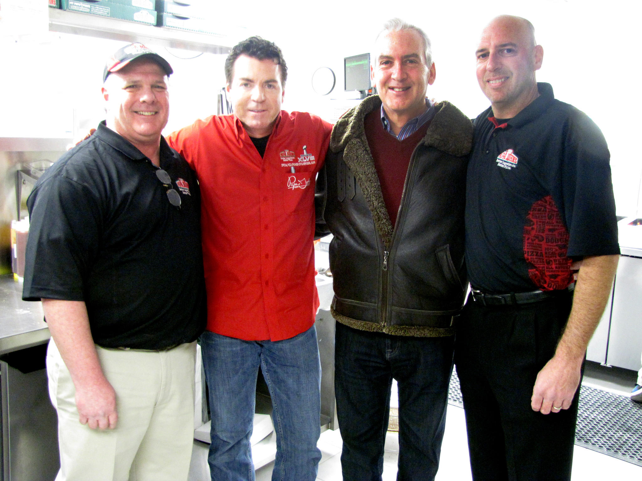 "At Papa John's Vernon restaurant, from left to right: Larry Litton, John ""Papa John"" Schnatter, Michael Gallon and David Kass."