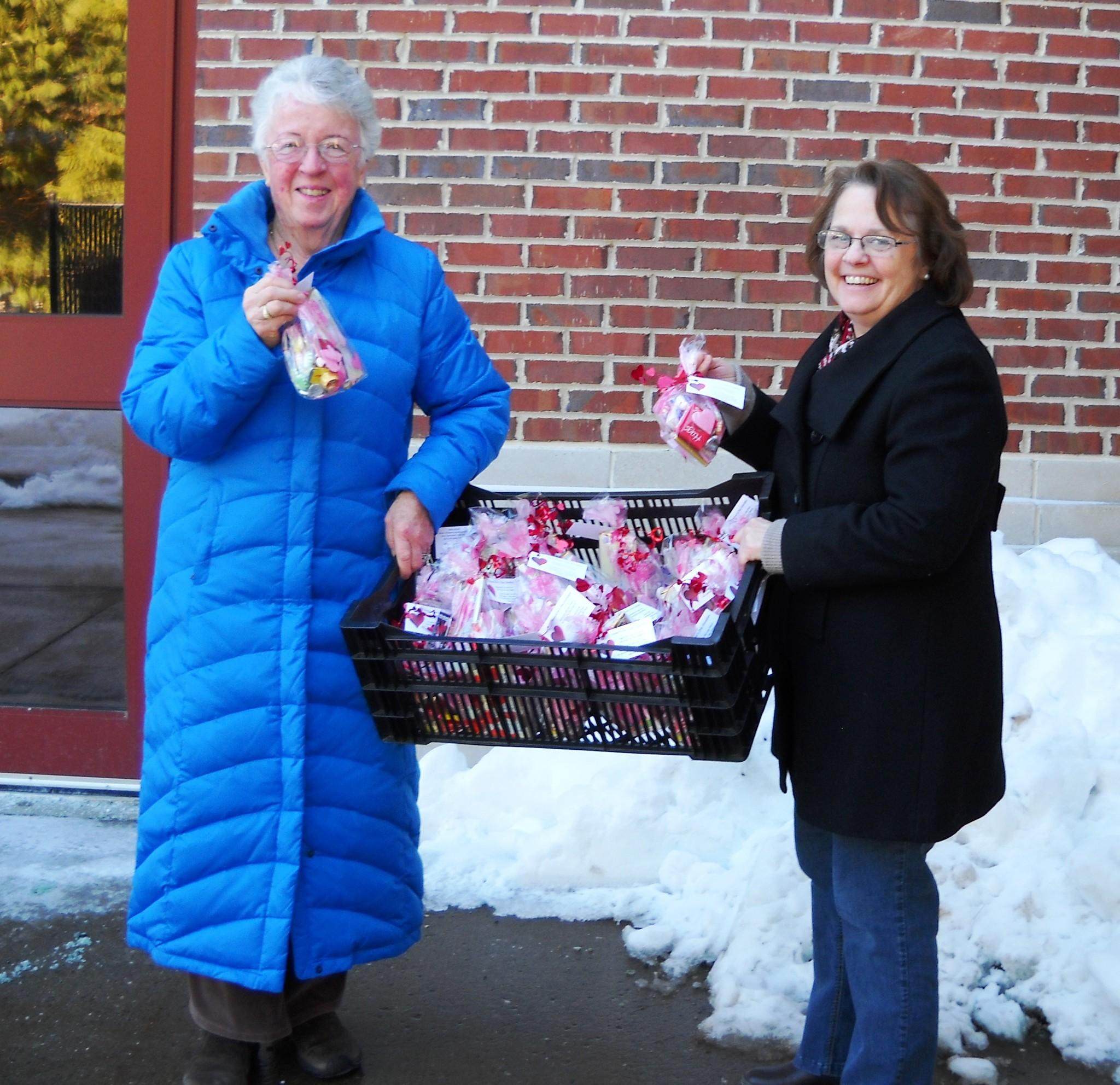From left to right: Pat Robotham and Diane Clerkin, board members and devoted volunteers for Services for the Elderly of Farmington, joined several other board members and put together lovely Valentine's Day-themed treats for Farmington seniors.