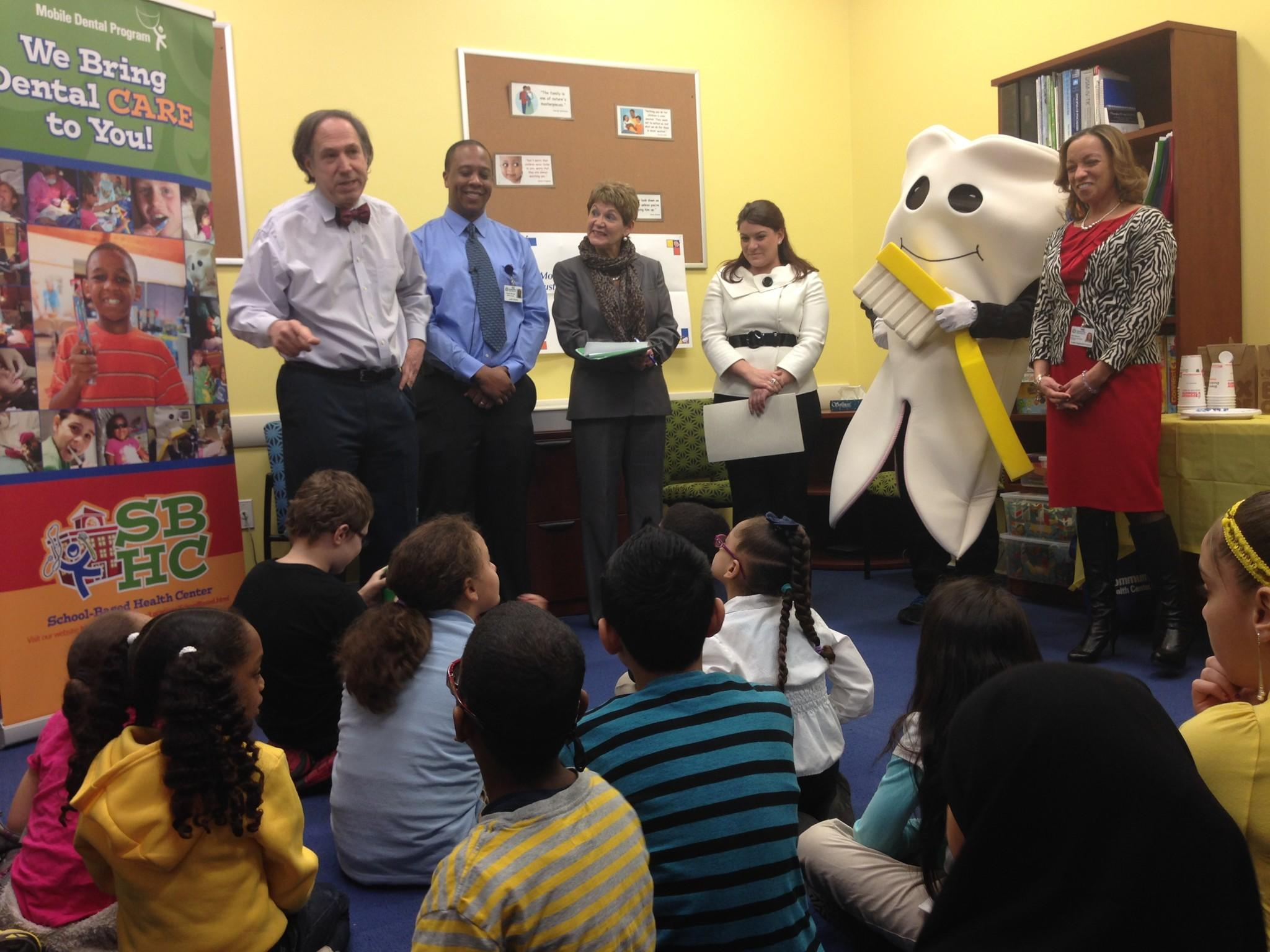 NB Mayor, Smalley Academy principal and CHC staff speak to students on 2/7, national Give Kids A Smile Day!.