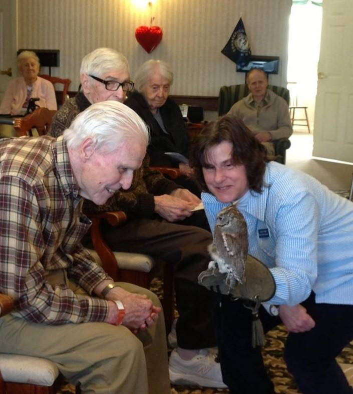Residents of Middlewoods of Newington get a closer look at one of the owls from Horizon Wings, a wildlife rehabilitation center that recently visited the community.