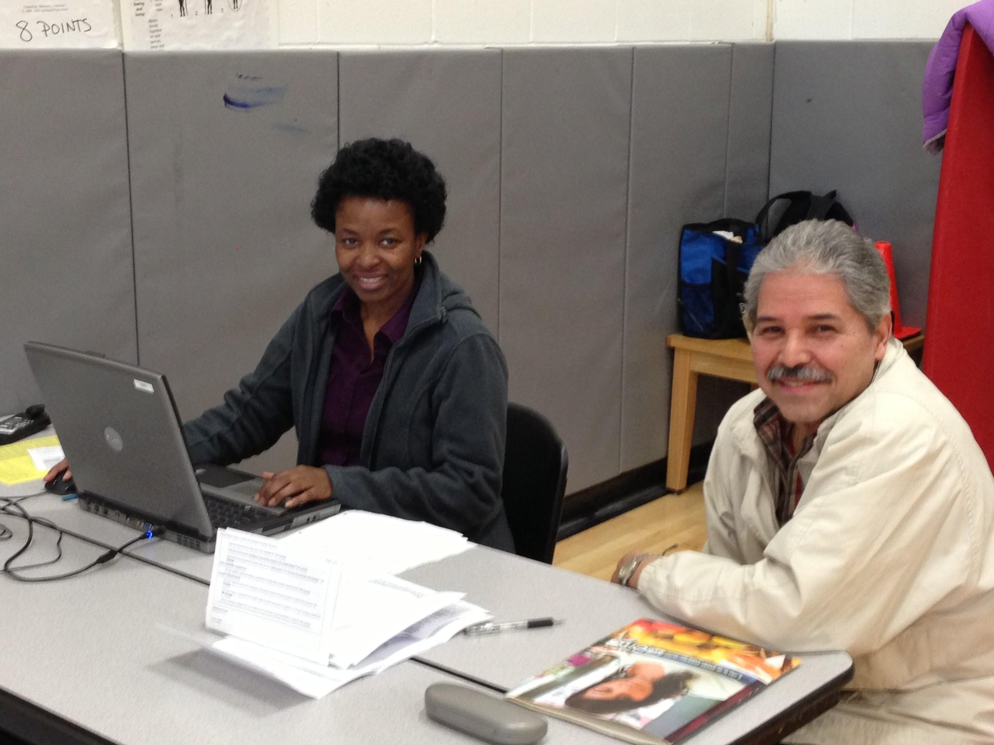 An IRS-certified volunteer taxpayer assisting a filer at the Alfred E. Burr Community School in Hartford.