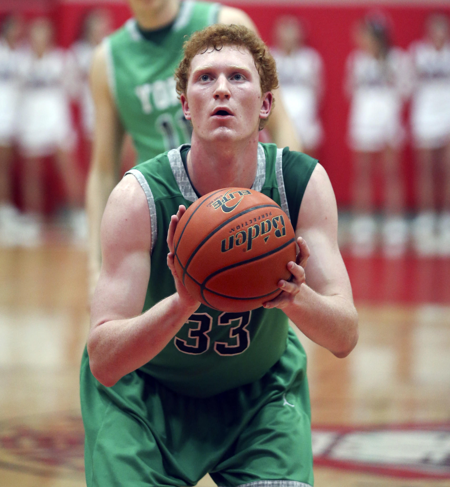 York #33 Frank Toohey lines up a free throw against Hinsdale Central on Tuesday, Feb. 18, 2014.