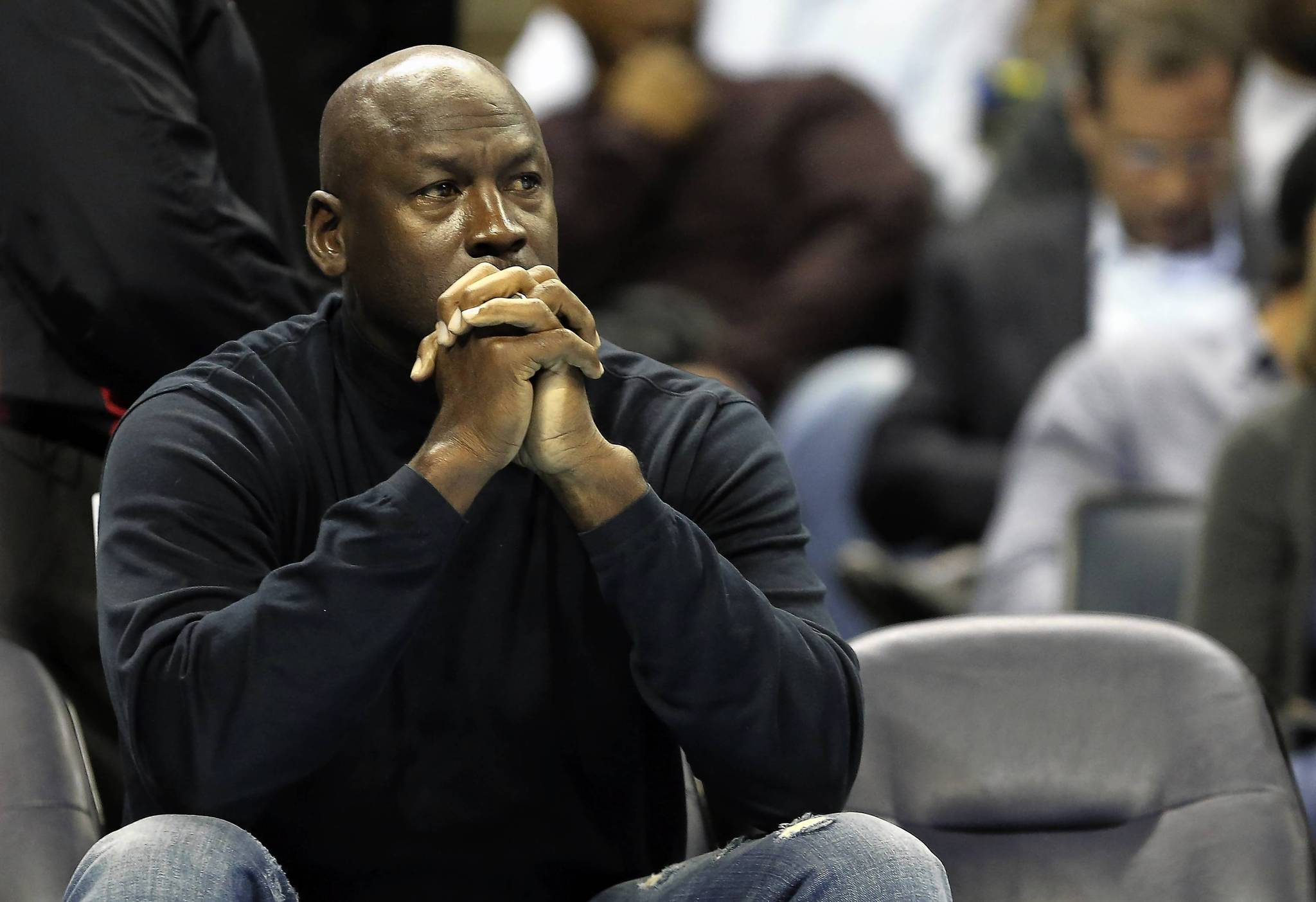 Michael Jordan watches a game against the Pacers.