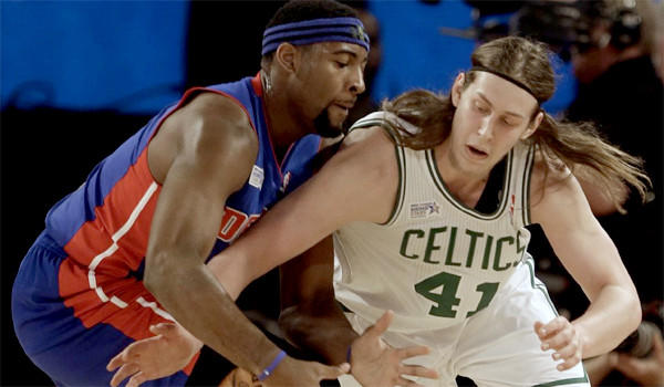 Boston's Kelly Olynyk battles for a loose ball with Detroit's Andre Drummond during the NBA Rising Stars Challenge game on Feb. 14. Olynyk and the Celtics will visit the Lakers at Staples Center on Friday.