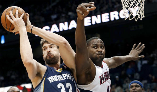 Memphis' Marc Gasol rips a rebound away from Atlanta's Elton Brand during the first half of a game on Feb. 8. Gasol had missed seven weeks because of a knee injury.