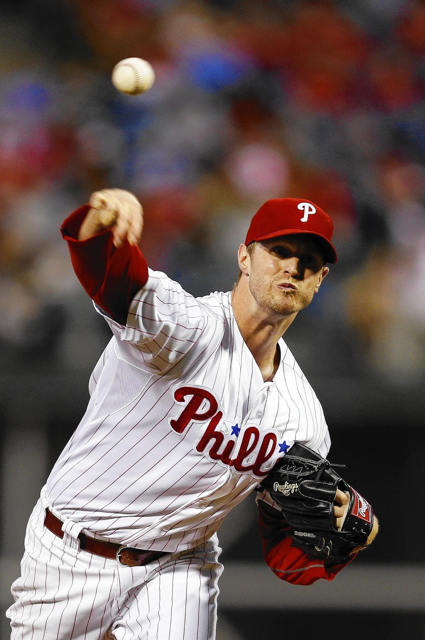 Starting pitcher Kyle Kendrick #38 of the Philadelphia Phillies throws a pitch during the game against the Colorado Rockies at Citizens Bank Park on August 22, 2013 in Philadelphia, Pennsylvania.
